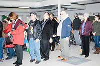 People line up to vote in the polling location for Manchester Ward 2 at Hillside Middle School in Manchester, New Hampshire, on the day of primary voting, Feb. 9, 2016.