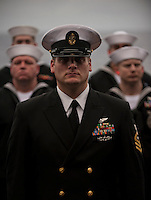 101227-N-7981E-135 PACIFIC OCEAN (Dec. 27, 2010)- Chief Aviation Boatswain's Mate (Handling) Luke Willdigg leads Sailors in a burial detail during a burial-at-sea aboard the aircraft carrier USS Carl Vinson (CVN 70).  Carl Vinson and Carrier Air Wing (CVW) 17 are on a deployment to the U.S. 7th and U.S. 5th Fleet areas of responsibility. (U.S. Navy photo by Mass Communication Specialist 2nd Class James R. Evans / RELEASED)