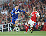 Arsenal's Santi Cazorla tussles with Chelsea's Eden Hazard during the Premier League match at the Emirates Stadium, London. Picture date September 24th, 2016 Pic David Klein/Sportimage