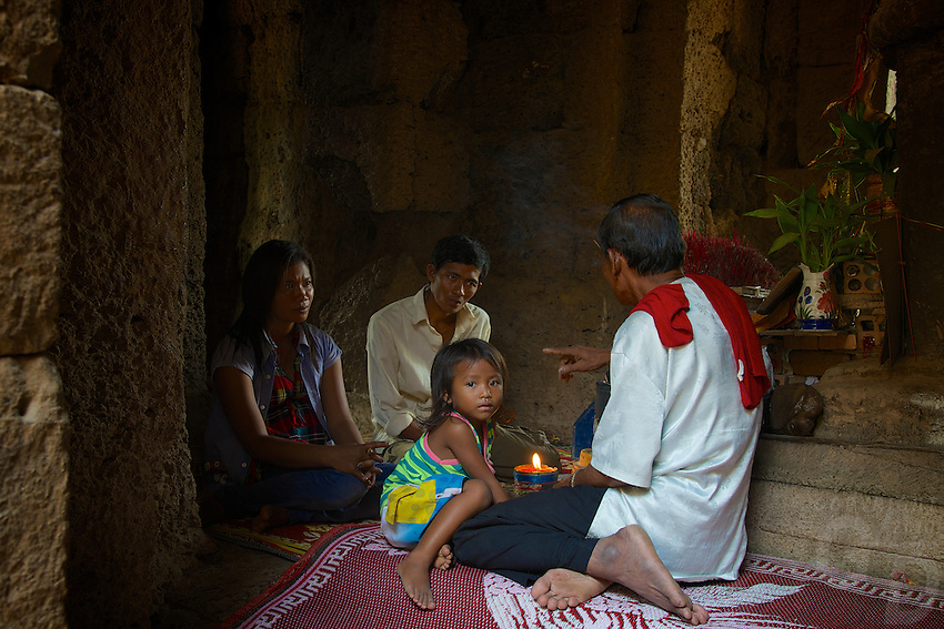 A local Khmer priest advising a local family at Prasat Taprom and Tonle Bati, Cambodia
