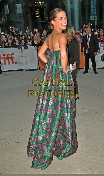 Alicia Vikander<br /> &quot;The Fifth Estate&quot; Premiere - 2013 Toronto International Film Festival held at Roy Thomson Hall, Toronto, Ontario, Canada. <br /> September 5th, 2013<br /> TIFF full length green strapless dress hands on hips pink floral print back behind rear looking over shoulder <br /> CAP/ADM/CC<br /> &copy;Chris Chew/AdMedia/Capital Pictures
