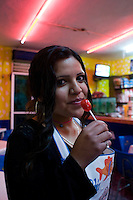 Portrait of waitress with lolipop. Night bike rides in Mexico City