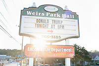 A sign announces a rally for real estate mogul and Republican presidential candidate Donald Trump at the Weirs Beach Community Center in Laconia, New Hampshire.