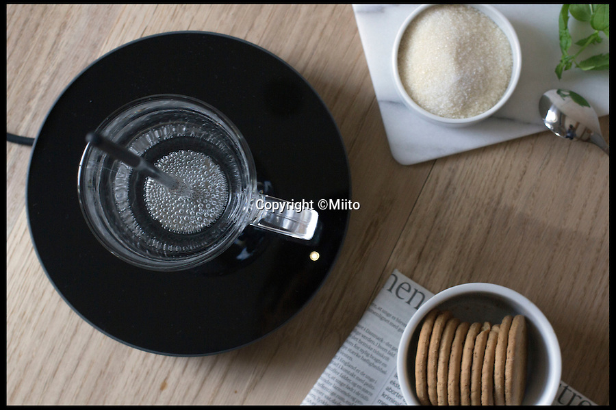 BNPS.co.uk (01202 558833)<br /> Pic: Miito/BNPS<br /> <br /> **Please use full byline**<br /> <br /> A mug of water being boiled using the Miito kettle.<br /> <br /> The humble kettle has been given a modern makeover finally putting paid to the problem of wasting energy by boiling more water than you need.<br /> <br /> The futuristic device allows tea drinkers to boil water directly in their mugs using state-of-the-art induction technology.<br /> <br /> The clever kettle heats water by placing a mug on a special induction plate then putting a magnetic metal rod in the liquid.<br /> <br /> The gadget, called Miito, is the brainchild of young entrepreneurs Nils Chudy and Jasmina Grase, former students of the Design Academy Eindhoven in the Netherlands.
