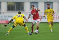 Fleetwood Town's Josh Morris under pressure from AFC Wimbledon's Paul Kalambayi<br /> <br /> Photographer Kevin Barnes/CameraSport<br /> <br /> The EFL Sky Bet Championship - Fleetwood Town v AFC Wimbledon - Saturday 10th August 2019 - Highbury Stadium - Fleetwood<br /> <br /> World Copyright © 2019 CameraSport. All rights reserved. 43 Linden Ave. Countesthorpe. Leicester. England. LE8 5PG - Tel: +44 (0) 116 277 4147 - admin@camerasport.com - www.camerasport.com