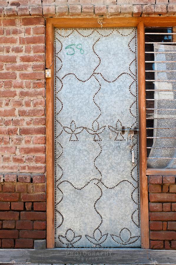 Artistic, decorated tin door, Srinagar, Kashmir, India.