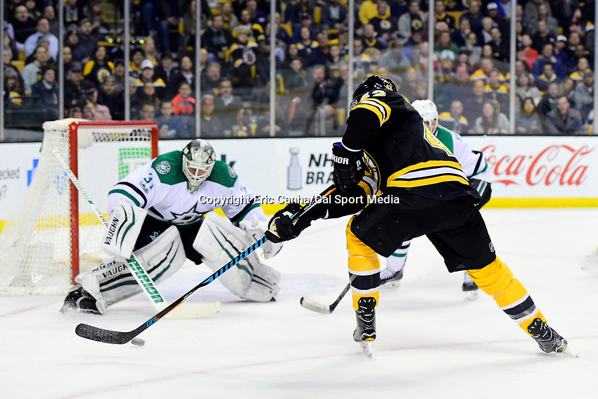 Thursday, March 30, 2017: Boston Bruins right wing David Backes (42) catches the rebounding puck from Dallas Stars goalie Antti Niemi (31) on his stick during the National Hockey League game between the Dallas Stars and the Boston Bruins held at TD Garden, in Boston, Mass. Eric Canha/CSM