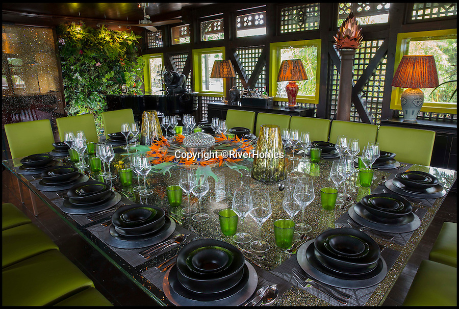 BNPS.co.uk (01202 558833)<br /> Pic: RiverHomes/BNPS<br /> <br /> The dining room decorated with four original Battle of Waterloo cannons and complete with a £80,000 dining room table encrusted with Swarovski crystals.<br /> <br /> The ultimate party pad...<br /> <br /> From the outside this 130-year-old Swiss chalet looks like a quirky old-fashioned property - but inside its the ultimate luxury home with a heated indoor beach, gold-covered bathroom and £500,000 kitchen.<br /> <br /> The Chalet Estate on the River Thames, next to Hampton Court Palace, is the ideal house for a wealthy party animal who wants to throw elaborate soirees.<br /> <br /> It is on the market with Riverhomes for £7.5million, but that's a bargain as the current owner has spent £4.7million completely overhauling the unusual property.