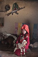 Kalsahnikov and lambs - Aziz house, with Chinor..In and around the campment of Kyzyl Qorum, campment of the former deceased Khan, Abdul Rashid Khan..Trekking with yak caravan through the Little Pamir where the Afghan Kyrgyz community live all year, on the borders of China, Tajikistan and Pakistan.