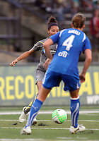 Estelle Johnson #24 of the Philadelphia Independence moves past Jordan Angeli #4 of the Boston Breakers during a WPS match at John A. Farrell Stadium on August 29 2010, in West Chester, PA. Breakers won 2-1.
