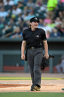 Home plate umpire Jennifer Pawol works a game between the Columbia Fireflies and Augusta GreenJackets on Friday, May 31, 2019, at Segra Park in Columbia, South Carolina. (Tom Priddy/Four Seam Images)