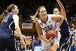 17 December 2013: Duke's Tricia Liston (32) is defended by UConn's Bria Hartley (right) and Breanna Stewart (30). The Duke University Blue Devils played the University of Connecticut Huskies at Cameron Indoor Stadium in Durham, North Carolina in a 2013-14 NCAA Division I Women's Basketball game. UConn won the game 83-61.