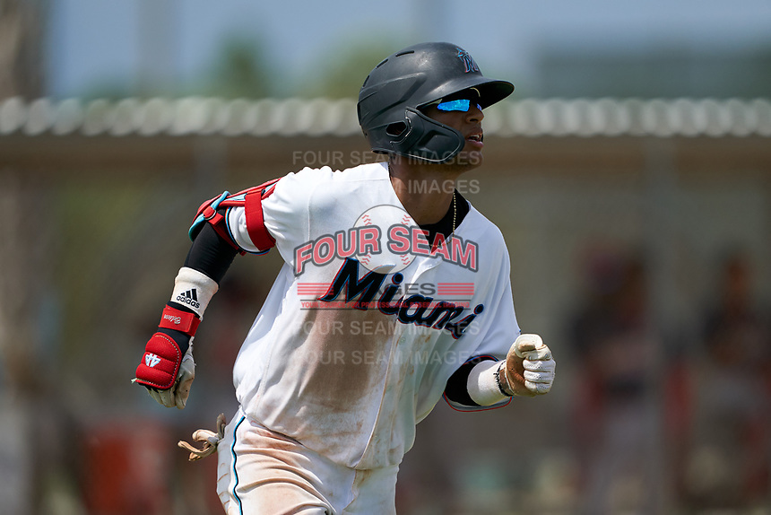 GCL Marlins Victor Mesa Jr. (9) runs to first base after hitting a double off the fence during a Gulf Coast League game against the GCL Cardinals on August 12, 2019 at the Roger Dean Chevrolet Stadium Complex in Jupiter, Florida.  GCL Marlins defeated the GCL Cardinals 9-2.  (Mike Janes/Four Seam Images)