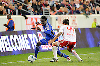 Kei Kamara (23) of the Kansas City Wizards is defended by Carlos Mendes (44) of the New York Red Bulls. The New York Red Bulls defeated the Kansas City Wizards 1-0 during a Major League Soccer (MLS) match at Red Bull Arena in Harrison, NJ, on October 02, 2010.