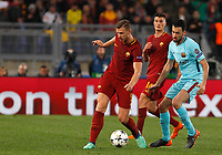 Roma s Edin Dzeko, left, is challenged by FC Barcelona Sergio Busquets during the Uefa Champions League quarter final second leg football match between AS Roma and FC Barcelona at Rome's Olympic stadium, April 10, 2018.<br /> UPDATE IMAGES PRESS/Riccardo De Luca