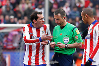 Atletico de Madrid´s Diego Godin receiving a yellow card