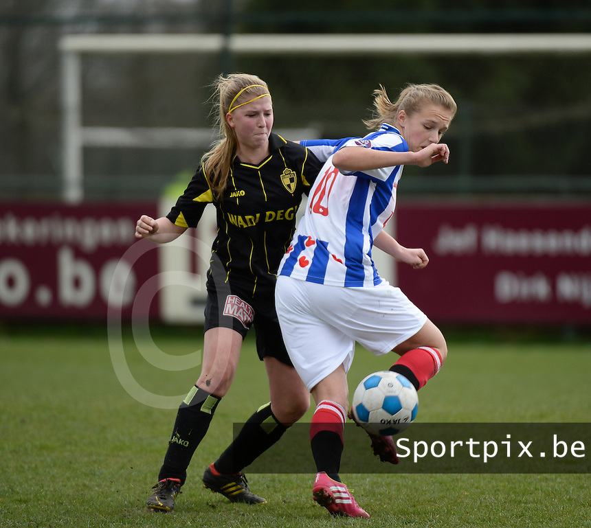 20140315 - WESTERLO , BELGIUM : Heerenveen Vivianne Miedema (r) pictured with Lierse Merel Groenen (l)  during the soccer match between the women teams of SK Lierse Dames  and SC Heerenveen Vrouwen , on the 19th matchday of the BeNeleague competition Saturday 15 March 2014 in Westerlo . PHOTO DAVID CATRY