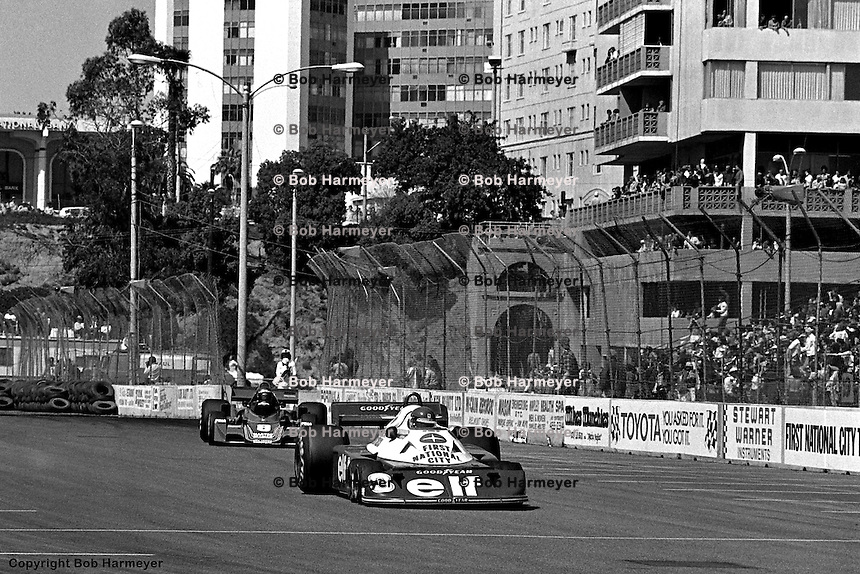 LONG BEACH, CA: Ronnie Peterson drives the Tyrrell P34 5/Ford Cosworth DFV ahead of Hans Stuck in the Ensign N177 MN-06/Ford Cosworth during the United States Grand Prix West on April 3, 1977, on the temporary street circuit in Long Beach, California.