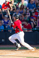 Kellin Deglan (6) of the Hickory Crawdads follows through on his swing against the Charleston RiverDogs at L.P. Frans Stadium on May 24, 2014 in Hickory, North Carolina.  The Crawdads defeated the RiverDogs 7-3.  (Brian Westerholt/Four Seam Images)