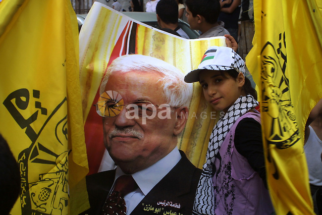 Palestinians hold Posters of President Mahmoud Abbas during a rally to support the election of President Mahmoud Abbas at  the sixth conference of Fatah in the Balata refugee camp in the West Bank city of Nablus on August 9, 2009. Photo by Nedal Shtieh