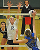 Shannon Brooks #12 of Massapequa, left, defends against a spike attempt by Emma McGovern #21 of Long Beach during the Nassau County varsity girls volleyball Class AA championship at SUNY Old Westbury on Tuesday, Nov. 8, 2016. Massapequa won 3-0.