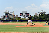 GCL Yankees 1 pitcher Orby Tavares (73) delivers a pitch with Raymond James Stadium in the background during the second game of a doubleheader against the GCL Braves on July 1, 2014 at the Yankees Minor League Complex in Tampa, Florida.  GCL Braves defeated the GCL Yankees 1 by a score of 3-1.  (Mike Janes/Four Seam Images)