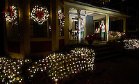 Beautiful Christmas lights glow along the walkways and homes along the annual Fourth Ward Holiday Home Tour route in Uptown Charlotte, North Carolina. This walkable, self-guided tour allows visitors to get into the Christmas holiday spirit while checking out the beautifully decorated home in Charlotte's historic Fourth Ward.  <br /> <br /> Charlotte Photographer - PatrickSchneiderPhoto.com