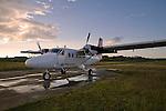Air Panama plane sitting on the runway in Carti during sunrise, San Blas Islands, Kuna Yala, Panama