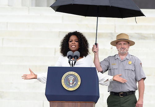Oprah Winfrey makes remarks at the Let Freedom Ring ceremony on the steps of the Lincoln Memorial to commemorate the 50th Anniversary of the March on Washington for Jobs and Freedom<br /> Credit: Ron Sachs / CNP