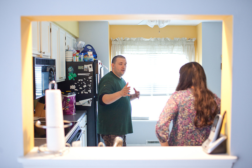 Stephen Yunis and his wife, Jenn Yunis, talk about their day before preparing dinner at their home in Germantown, Maryland on May 18, 2013. Mr. Yunis says that keeping active with passtimes like paintball helped him deal with the trials he experienced with infertility. His wife, Jenn Yunis, has finally become pregnant after many attempts, with the help of Shady Grove Fertility Center in Rockville, Maryland.