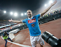Napoli's Napoli's Gonzalo Higuain  celebrates at  end of the  italian serie a soccer match,between SSC Napoli and Sassuolo    at  the San  Paolo   stadium in Naples  Italy ,Napoli  wins  3-1
