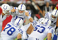 Sept. 27, 2009; Glendale, AZ, USA; Indianapolis Colts quarterback (18) Peyton Manning talks with teammates in the huddle against the Arizona Cardinals at University of Phoenix Stadium. Indianapolis defeated Arizona 31-10. Mandatory Credit: Mark J. Rebilas-