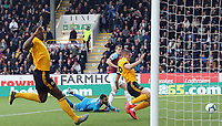 Burnley's Chris Wood scores the opening goal past Wolverhampton Wanderers' Rui Patricio and despite the attentions of Conor Coady<br /> <br /> Photographer Rich Linley/CameraSport<br /> <br /> The Premier League - Burnley v Wolverhampton Wanderers - Saturday 30th March 2019 - Turf Moor - Burnley<br /> <br /> World Copyright © 2019 CameraSport. All rights reserved. 43 Linden Ave. Countesthorpe. Leicester. England. LE8 5PG - Tel: +44 (0) 116 277 4147 - admin@camerasport.com - www.camerasport.com