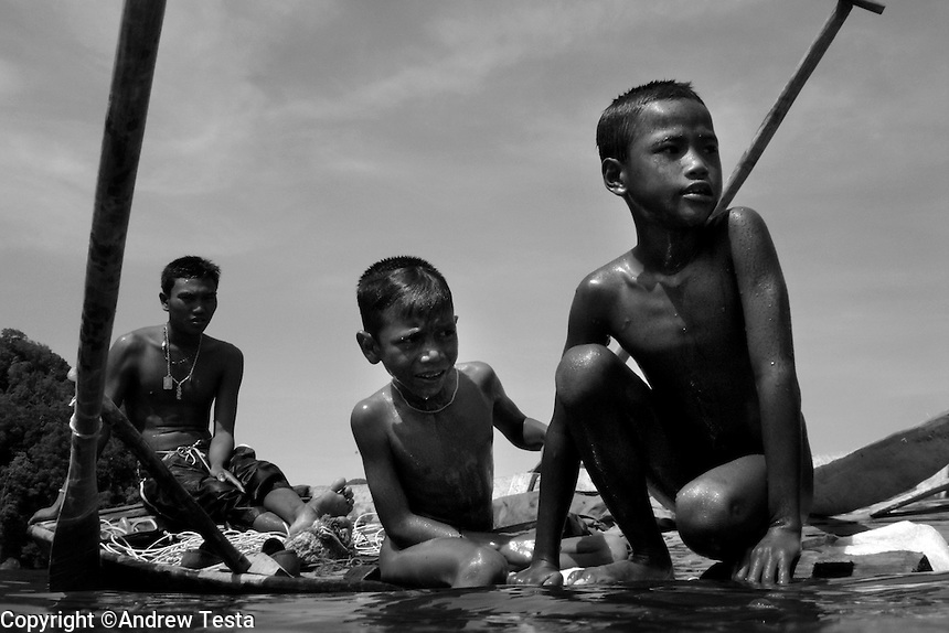 ".The Moken are a nomadic tribe who live on the Surin Islands islands 60 km off the coast of Thailand. Recent scientific studies have shown that the underwater eyesight of Moken children is more than50% percent better than the underwater eyesight of other children. Scientists believe that the Moken train their eyes to see better out of necessity, they have to hunt for fish, and also make out things on the sea bed far below them. Experiments are now underway in Sweden to see if other children can train their eyes in a similar way. The Moken spend a large part of their time in the sea, and seem almost as at home in that environment as on land. At present they have no Family names or citizensip, but the Thai authorities have proposed that they all be given the same second name, roughly translated it means ""Hero of the Sea"". The entire Moken population of the Surin Islands survived the recent Tsunami. News reports say that by the time the waves crashed ashore, the Moken were already on the higher ground and therefore safe. According to interviews they relied on the sayings of their ancestors which have been passed down through generations (they have no written language) which warn of the sea disappearing and then returning with a terrible force."