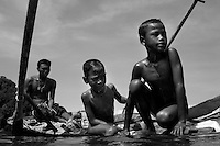 """.The Moken are a nomadic tribe who live on the Surin Islands islands 60 km off the coast of Thailand. Recent scientific studies have shown that the underwater eyesight of Moken children is more than50% percent better than the underwater eyesight of other children. Scientists believe that the Moken train their eyes to see better out of necessity, they have to hunt for fish, and also make out things on the sea bed far below them. Experiments are now underway in Sweden to see if other children can train their eyes in a similar way. The Moken spend a large part of their time in the sea, and seem almost as at home in that environment as on land. At present they have no Family names or citizensip, but the Thai authorities have proposed that they all be given the same second name, roughly translated it means """"Hero of the Sea"""". The entire Moken population of the Surin Islands survived the recent Tsunami. News reports say that by the time the waves crashed ashore, the Moken were already on the higher ground and therefore safe. According to interviews they relied on the sayings of their ancestors which have been passed down through generations (they have no written language) which warn of the sea disappearing and then returning with a terrible force."""