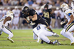 Cade Carney (36) of the Wake Forest Demon Deacons fights for extra yards after being hit by Step Durham (8) of the Georgia Tech Yellow Jackets during first half action at Bobby Dodd Stadium on October 21, 2017 in Atlanta, Georgia.  The Yellow Jackets defeated the Demon Deacons 38-24. (Brian Westerholt/Sports On Film)