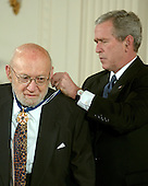 "Washington, D.C. - December 15, 2006 -- Joshua Lederberg receives the Presidential Medal of Freedom  from United States President George W. Bush and first lady Laura Bush during a ceremony in the East Room of the White House on Friday, December 15, 2006.  The medal is the nation's highest civil award.  It may be awarded ""to any person who has made an especially meritorious contribution to (1) the security or national interests of the United States, or, (2) world peace, or (3) cultural or other significant public or private endeavors"".  Dr. Joshua Lederberg has devoted his life to the advancement of human knowledge across a remarkable range of scientific endeavor.  His work in bacterial genetics earned him a Nobel Prize and laid the groundwork for future progress in the study of genetics.  He has helped develop advanced computer technology, worked with NASA in the search for life on Mars, and served as a distinguished scientific advisor to our Nation's policymakers.  The United States honors Joshua Lederberg for his achievements in scientific discovery and his commitment to improving the lives of others.<br /> Credit: Ron Sachs / CNP"