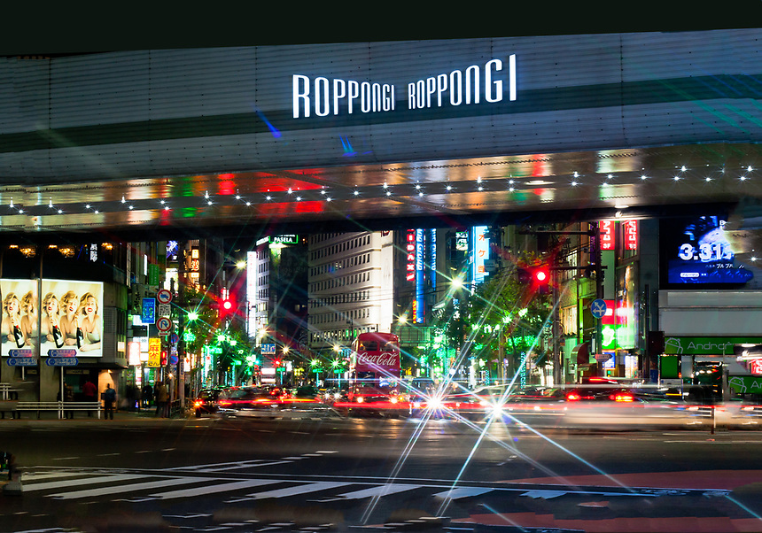 Roppongi crossing at night - Tokyo`s famous entertainment district with a London double decker bus in shot.
