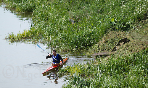 26 MAY 2013 - BRIGG, GBR - A competitor starts the kayak leg of the 2013 Brigg Bomber Quadrathlon, a World Quadrathlon Federation World Cup round and the British Championships, held in Brigg in Lincolnshire, Great Britain (PHOTO (C) 2013 NIGEL FARROW)