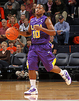 Jan. 2, 2011; Charlottesville, VA, USA; LSU Tigers guard Andre Stringer (10) dribbles the ball during the game against the Virginia Cavaliers at the John Paul Jones Arena. Mandatory Credit: Andrew Shurtleff