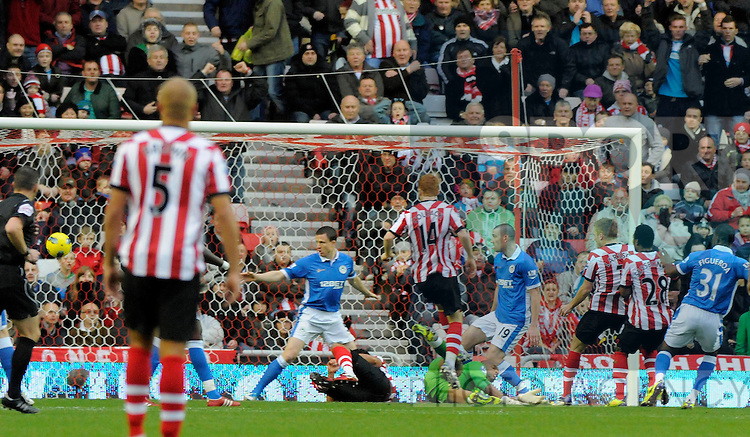 Sebastian Larsson of Sunderland AFC (3rd R) scores his side's first goal during the Premier League football match between Sunderland AFC and Wigan Athletic on 26 November 2011, at Stadium of Light, Sunderland, England.