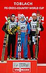 (From L) Switzerland's Dario Cologna, Russia's Alexander Legkov, Sweden's Marcus Hellner pose at the podium of the FIS Ski World Cup Men' 15 Km Individual Classic, on February 1, 2014 in Dobbiaco, Toblach.<br /> <br /> &copy; Pierre Teyssot