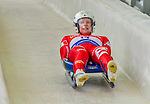 5 December 2014: Kevin Fischnaller, sliding for Italy, crosses the finish line on his first run, ending the day with a 18th place finish and a combined 2-run time of 1:44.089 in the Men's Competition at the Viessmann Luge World Cup, at the Olympic Sports Track in Lake Placid, New York, USA. Mandatory Credit: Ed Wolfstein Photo *** RAW (NEF) Image File Available ***