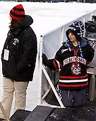 Brenda Maguire and Gavin Nareski - The University of New Hampshire Wildcats defeated the Northeastern University Huskies 5-3 (EN) on Friday, January 8, 2010, at Fenway Park in Boston, Massachusetts as part of the Sun Life Frozen Fenway doubleheader.