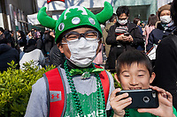"Young Japanese boys  dressed in green enjoy the 27th Saint .Patrick's Day Parade in Omotesando, Tokyo, Japan. Sunday March 17th 2019. Started in 1992 by the Irish Network, Japan, and supported by the Embassy of Ireland,; the parade, along with the ""I Love Ireland Festival"" held nearby is Asia's  largest Irish event."