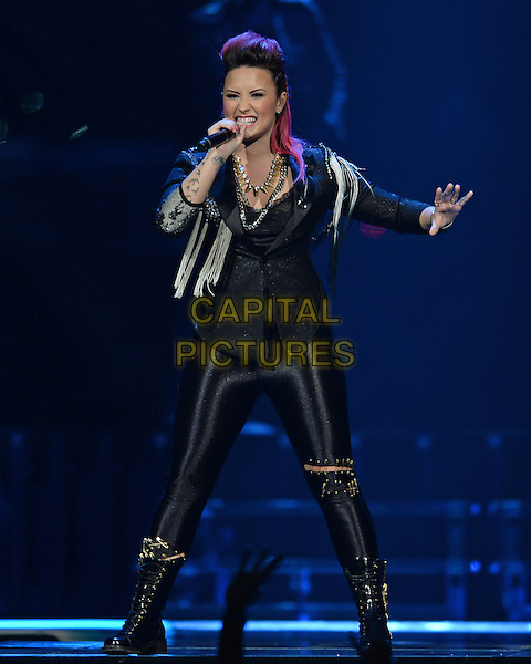 SUNRISE, FL - FEBRUARY 25 : Demi Lovato performs at the BB&amp;T Center on February 25, 2014 in Sunrise Florida, USA.<br /> CAP/MPI/mpi04<br /> &copy;mpi04/MediaPunch/Capital Pictures