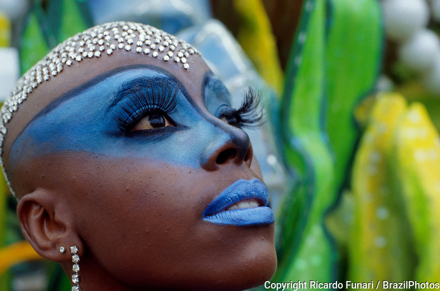 Face adornments and body painting, Samba Schools Parade, Rio de Janeiro carnival in Brazil - wig made of small pieces of mirror simulating diamonds.