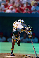 ST. LOUIS, MO - Barry Bonds of the Pittsburgh Pirates falls down at home plate while batting during a game at Busch Stadium in St. Louis, Missouri on September 30, 1990. Photo by Brad Mangin