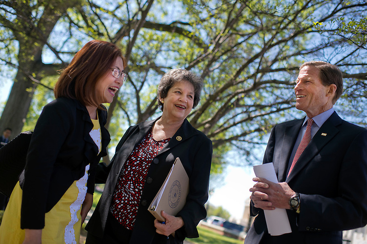 "UNITED STATES - APRIL 20: From left, Shandra Woworuntu, a survivor of sex-trafficking, Rep. Lois Frankel, D-Fla., and Sen. Richard Blumenthal, D-Conn., prepare for a news conference to announce ""The Visa Transparency Anti-Trafficking Act,"" at the Senate Swamp on the East Front of the Capitol, April 20, 2016. (Photo By Tom Williams/CQ Roll Call)"