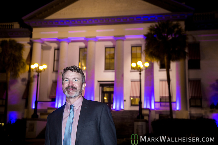 Brian Callanan, founder and executive director of the Cystic Fibrosis Lifestyle Foundation, from Miami, in front of the Florida Capitol during the Light Up CF event by the Cystic Fibrosis Lifestyle Foundation at the Florida Capitol in Tallahassee, Florida.
